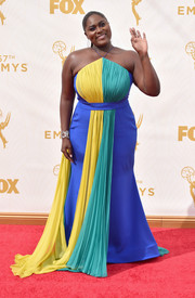 Danielle Brooks donned a Christian Siriano halter gown in a trio of bright colors for her Emmy Awards look.