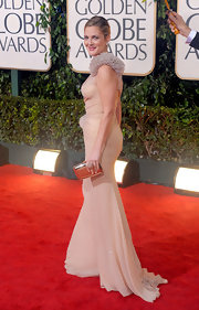 "The actress had a moment on the red carpet in a stunning Atelier Versace gown and a flashy metallic ""Silver Box Clutch""."