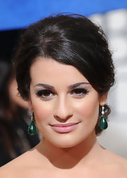 Lea completed her elegant updo with emerald green dangle earrings.