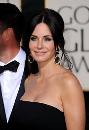 Courtney showed off an elegant French twist at the Golden Globe Awards. A sleek center part finished off her look.