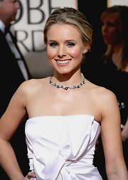 Kristen Bell paired her ruched strapless dress with a gemstone collar neckalce.