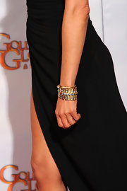 Jennifer wore a stunning rare 19th century Egyptian revival enamel and gold link bracelet by  Fred Leighton