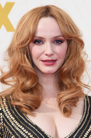 Christina Hendricks wore gorgeous face-framing curls with center-parted bangs during the Emmy Awards.