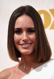 Louise Roe attended the Emmy Awards showing off a sleek center-parted bob.
