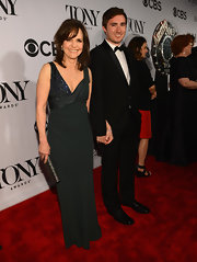 Sally Field wore a dark green gown that featured a draped detail that exposed a beaded accent.