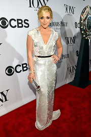 Jane Krakowski sparkled in a silver beaded gown that featured a deep V-neck and a cinched waist.