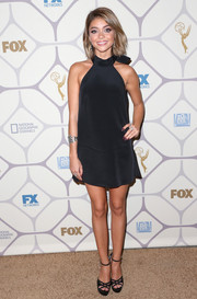 Sarah Hyland teamed her cute dress with black cutout platform sandals by Jimmy Choo.