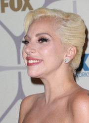 Lady Gaga glammed up her look with this classic French twist when she attended the Emmy Awards Fox after-party.