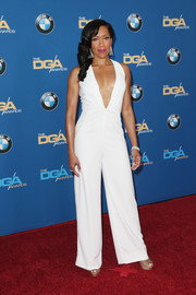 Regina King went bold at the Directors Guild of America Awards in a white jumpsuit with a down-to-the-navel neckline.