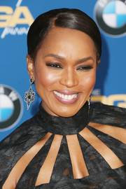 Angela Bassett attended the Directors Guild of America Awards wearing her hair in a sleek side-parted ponytail.