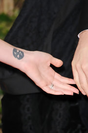 Megan Fox showed off a tattoo on the inner wrist of her left arm at the 68th Annual Golden Globe Awards.