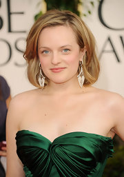 Elizabeth Moss gave the red carpet a nice pop of color in her emerald green dress. The actress completed her stunning look with cascading diamond earrings.
