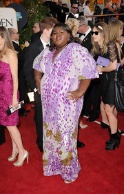 "Gabourey Sidibe hit the red carpet in a glittering kimono dress that, in the words of one friend, resembles ""a botanical garden of sequins."" The violet hues are well-suited to Gabourey, who knows how to pose."