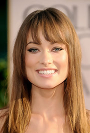 Olivia Wilde added a smoky touch to her look with a smoldering brown eye. She opted for a natural glow and light gloss.