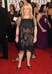 Jacki matched her beaded dress with classic black peep-toe pumps and a red pedicure for the Golden Globes.