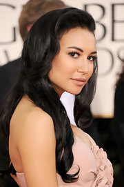 Naya Rivera looked ultra-glam at the 2011 Golden Globe Awards. She paired her blush colored dress with long raven curls.