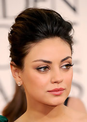 Mila Kunis added high drama to her look with defined lashes.