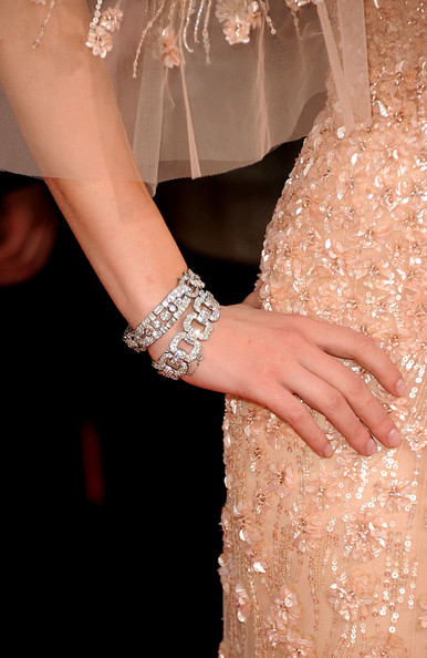 Scarlett Johansson paired her sequined blush gown with decadent diamond bracelets.