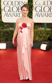 Natalie was glowing in a strapless pale pink silk gown with a dramatic sparkling red rose.