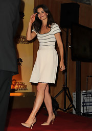 Katie Holmes paired a demure cap sleeve dress with nude Jimmy Choo pumps. The pointy toe heels were a chic and sophisticated choice.