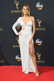Heidi Klum went ultra modern in a one-sleeve silver cutout gown by Michael Kors for her Emmys look.