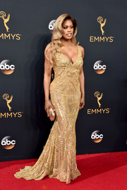 Laverne Cox radiated in a beaded gold fishtail gown by Naeem Khan during the Emmy Awards.
