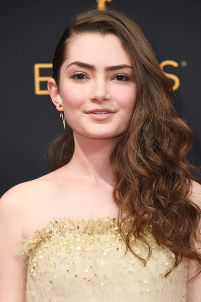 Emily Robinson styled her tresses into voluminous half-pinned curls for the Emmy Awards.