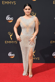Ariel Winter complemented her gown with silver ankle-strap heels by Stuart Weitzman.