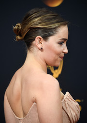 Emilia Clarke pulled her locks back into a twisted bun for her Emmy Awards look.
