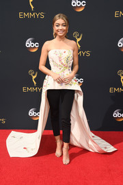 Gold Jimmy Choo sandals polished off Sarah Hyland's ensemble.