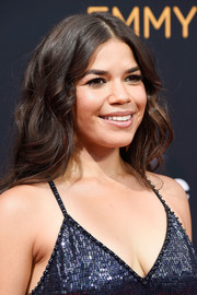 America Ferrera attended the Emmys wearing high-volume center-parted waves.