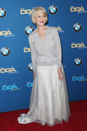 Helen Mirren paired her sweater with an ivory ball skirt for a touch of glamour.
