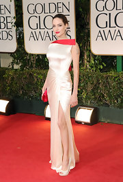 Angelina Jolie smoldered in a white satin evening dress with a red accent for the Golden Globes.