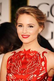 Dianna Agron wore a classic red lipstick to match her laser-cut gown at the 69th Annual Golden Globe Awards.