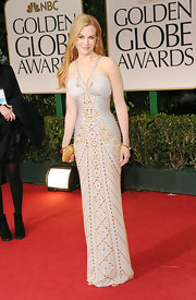 Nicole Kidman showed off her svelte figure in a silver and gold studded gown for the Golden Globes.