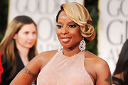 Mary J. Blige wore her hair in a side-swept updo featuring big glamorous curls at the 69th Golden Globe Awards.