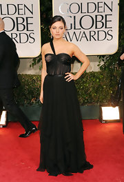Mila Kunis wore a black chiffon evening dress for the Golden Globe Awards.
