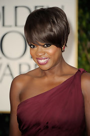Viola Davis wore a pair of ruby and diamond flower cluster earrings in gold at the 69th Annual Golden Globe Awards.