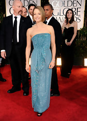 Jodie Foster showed off her toned arms at the Golden Globe Awards in a strapless beaded aqua dress.
