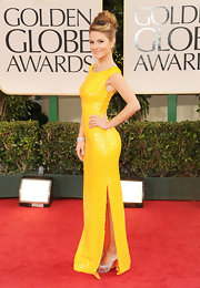"Maria topped off her bright yellow gown with gray ""Very Croise"" pumps."