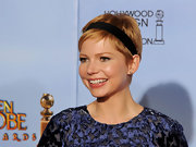 Michelle Williams accented her darling pixie hair cut with a velvet headband at the 69th Annual Golden Globe Awards.