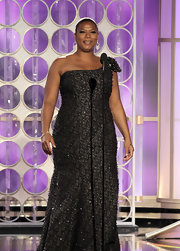 Queen Latifah wore a beaded single-shoulder gown for presenting at the Golden Globes.