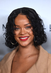 Rihanna brightened up her smile with some matte red lipstick.