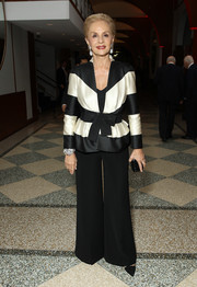Carolina Herrera paired a fitted black-and-white jacket with wide-leg pants for the Parsons Benefit.