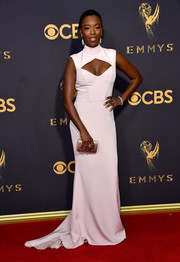 Samira Wiley paired her dress with a blush satin clutch by Jimmy Choo.
