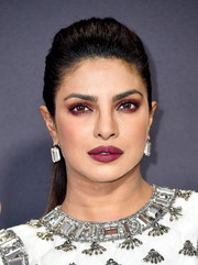 Priyanka Chopra went for a bold and sexy beauty look with a smoky application of purple eyeshadow.