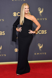 Nancy O'Dell kept it simple and classic with this black one-sleeve column dress at the 2017 Emmys.