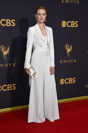 Evan Rachel Wood complemented her suit with an embellished white satin clutch by Jimmy Choo.