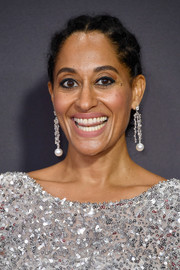 Tracee Ellis Ross complemented her glittery dress with a pair of dangling pearl and diamond earrings by Irene Neuwirth.