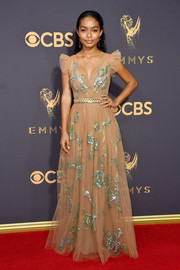 Yara Shahidi chose a nude Prada tulle gown with green sequin embellishments for her 2017 Emmys red carpet look.